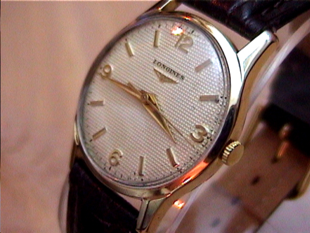 Longines gold watches